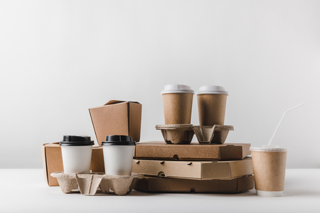 pizza boxes and coffee to go with take away boxes on tabletop Archivio Fotografico - 99973024