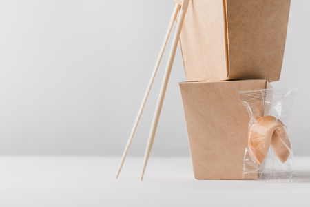 noodles boxes with chopsticks and chinese fortune cookie on table Stock Photo