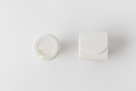 top view of disposable coffee cup and noodles box on white surface Stock Photo