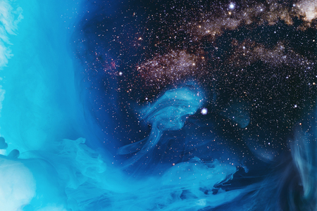 full frame image of mixing turquoise, blue and black paint splashes in water with universe background Stock Photo