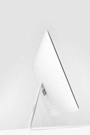 side view of desktop computer display on white