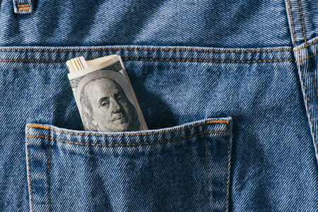 close up view of roll of dollar banknotes in jeans pocket Stok Fotoğraf