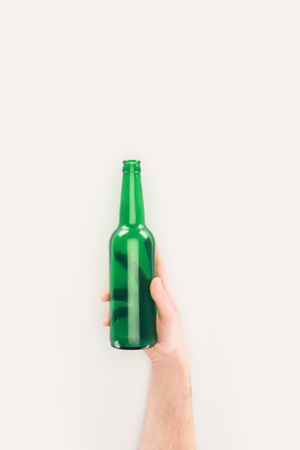 cropped shot of man holding empty beer bottle isolated on white