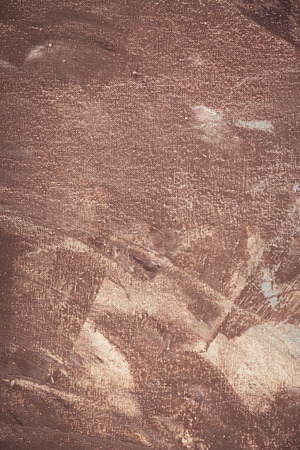 close up of brown brush strokes on abstract acrylic background