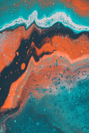 close up of abstract background with blue and orange acrylic paint