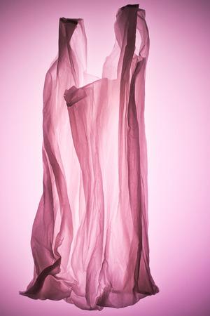 transparent plastic bag under pink toned light Stock Photo
