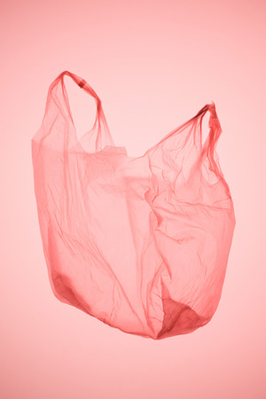 empty plastic bag under pastel pink toned light Stock Photo