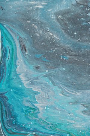 close up of abstract texture with light blue and grey oil paint