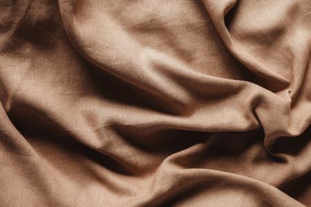 top view of beige linen tablecloth texture