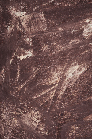 close up of brown paint brush strokes on abstract texture