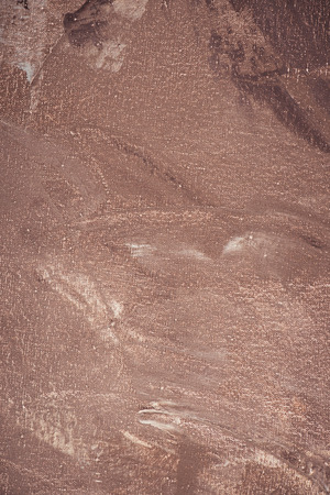 close up of brown brush strokes on abstract texture