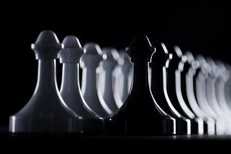rows of white and black chess figures isolated on black, business concept Stok Fotoğraf - 101300794