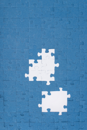 top view of puzzles with missing elements, business concept Фото со стока