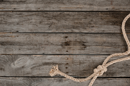 top view of nautical rope with knot on grunge wooden surface Stock fotó