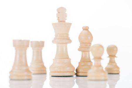 white wooden chess figures on white reflecting surface Stok Fotoğraf - 101301905