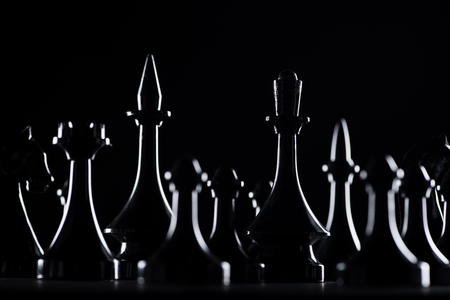 silhouettes of chess figures isolated on black, business concept Stok Fotoğraf