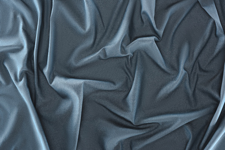 close up view of crumpled blue silk fabric as background