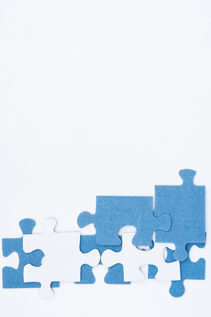 top view of white and blue puzzles isolated on white, business concept Foto de archivo - 101308275