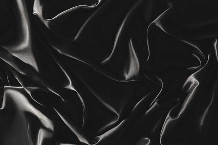 Plein cadre de tissu de soie élégant noir comme arrière-plan