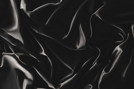 Vollrahmen aus schwarzem, elegantem Seidentuch als Hintergrund
