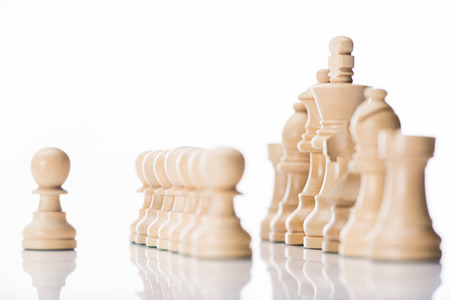 white chess figures on white reflecting surface