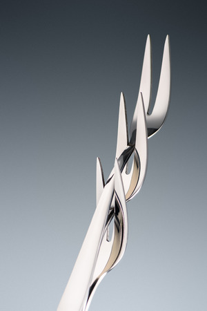 three forks with two tines isolated on grey