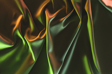 close up view of dark crumpled silk cloth as backdrop Stock fotó