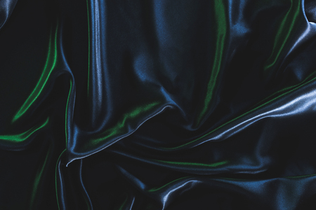 full frame of dark elegant silk fabric as background 写真素材