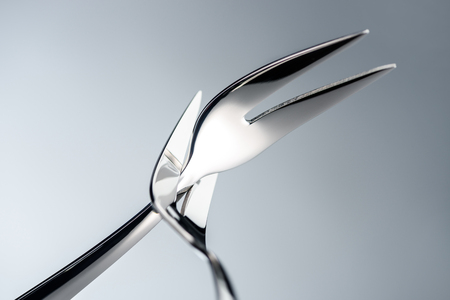 fondue forks with two tines isolated on grey 写真素材