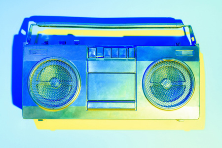 blue toned picture of retro boombox on blue background