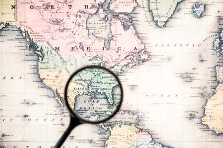 top view of magnifying glass on world map over gulf mexico Stok Fotoğraf