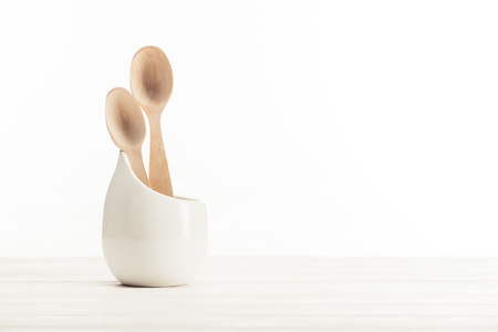 closeup shot of two wooden spoons on white background