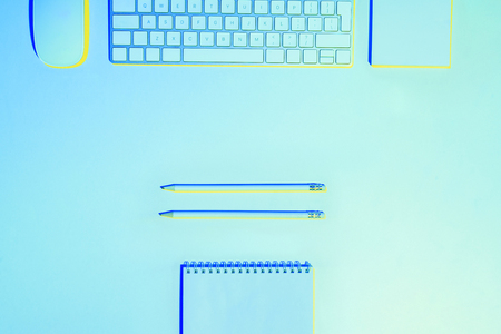 blue toned picture  of computer keyboard and mouse, pencils and empty textbook  Stock Photo