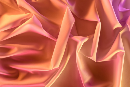 close up view of elegant pink silky fabric as background
