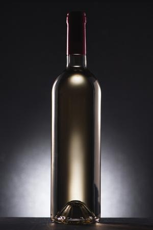 single bottle of delicious white wine on black