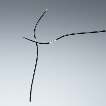 two forks with two tines isolated on grey
