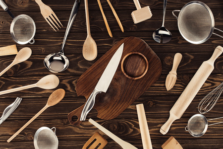 top view of different kitchen utensils on wooden table Stock Photo - 103198424
