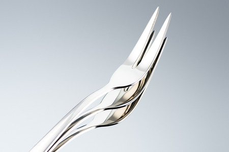 dessert forks with two tines isolated on grey