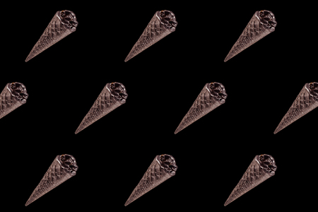 top view of pattern of chocolate black ice cream isolated on black