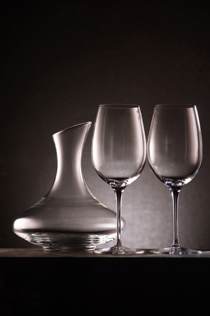 still life of empty decanter and wineglasses on black