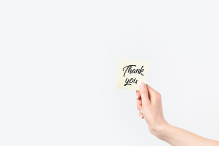partial view of woman holding thank you card