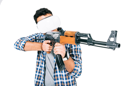 young african american man in checkered shirt and virtual reality headset holding rifle isolated on white