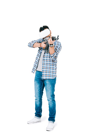 young african american man in virtual reality headset holding rifle and shooting isolated on white Stockfoto