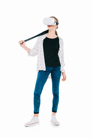 confident young woman in virtual reality headset holding baseball bat isolated on white