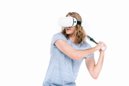 young man in virtual reality headset playing baseball isolated on white