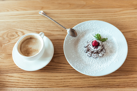top view of cup of coffee and sweet dessert on wooden table in cafe Stock fotó - 101981486