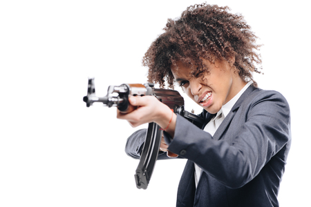 african american female secret agent aiming with rifle, isolated on white