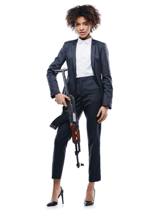 african american female spy in suit with rifle, isolated on white