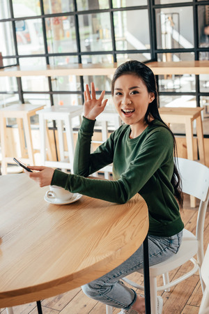 Portrait of young asian woman spending time in cafe Banque d'images - 102585727