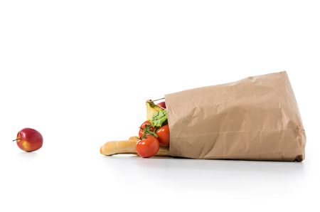 fresh ripe fruits and vegetables in brown paper bag isolated on white Stock Photo